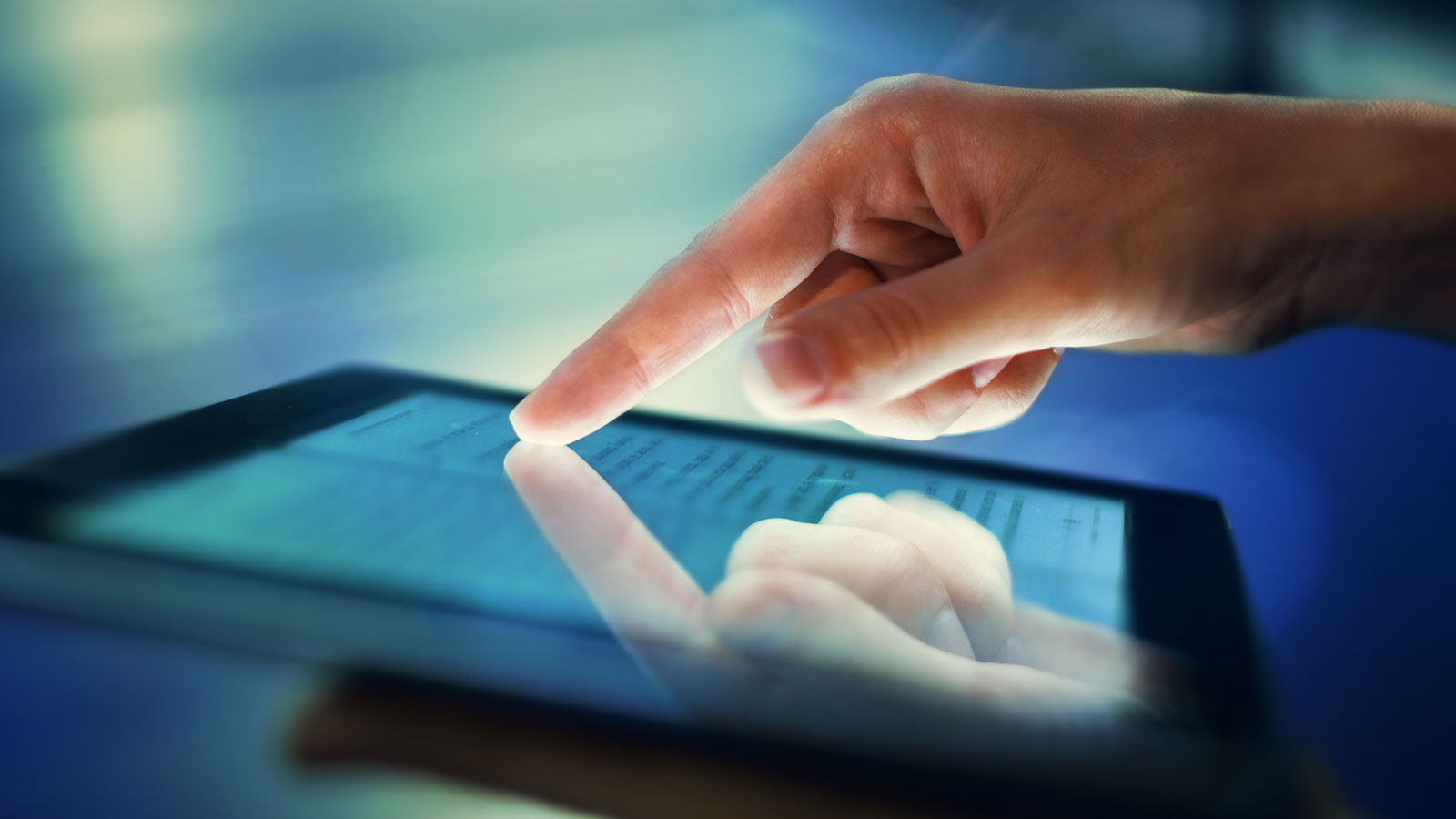 Finger touching tablet