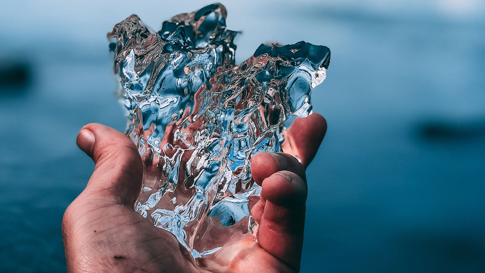 Hand holding a large piece of ice