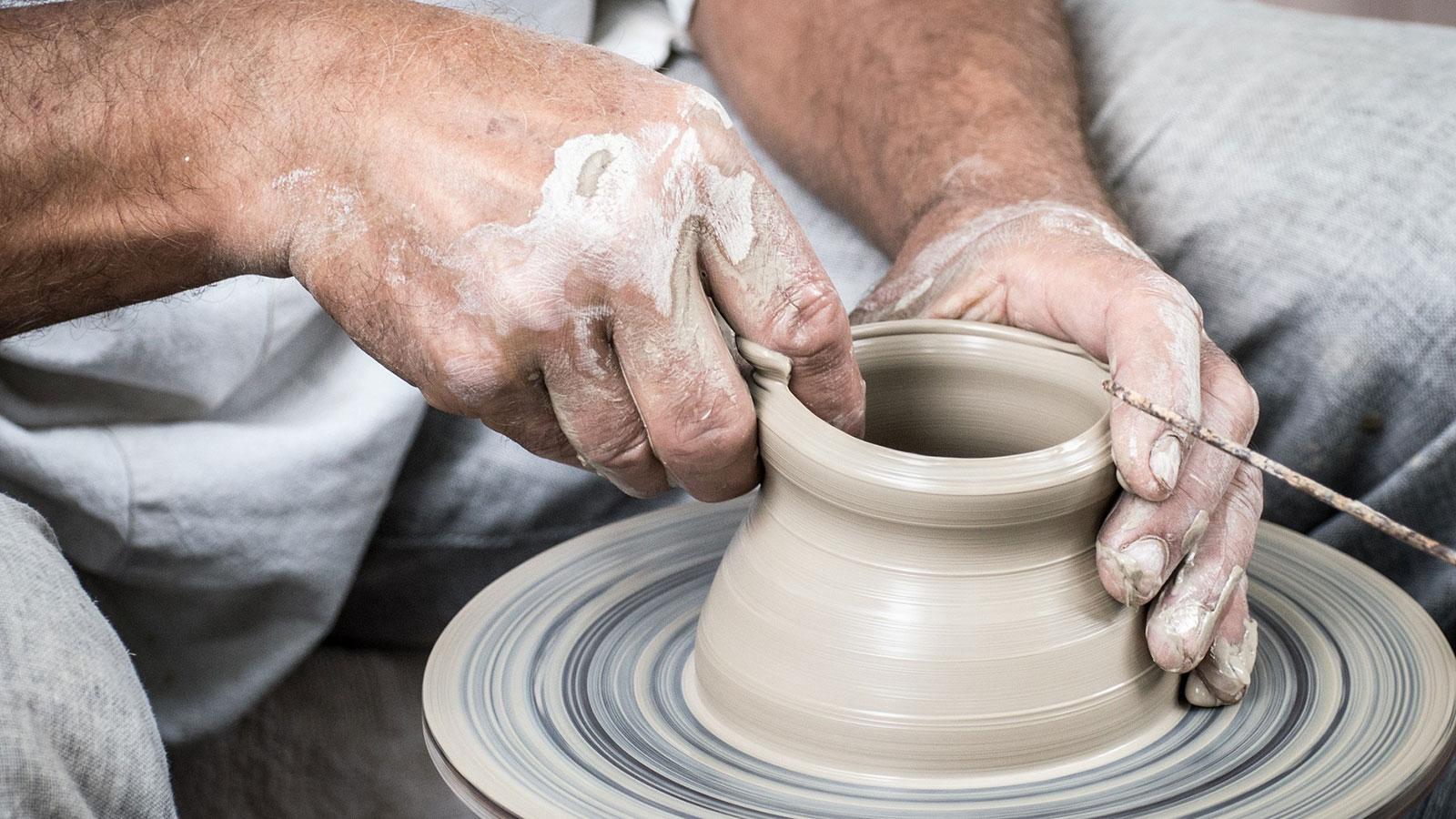 Man pottery wheel