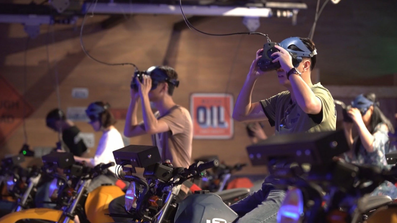 People on motorcylces with VR headsets with Ultraleap tracking technology