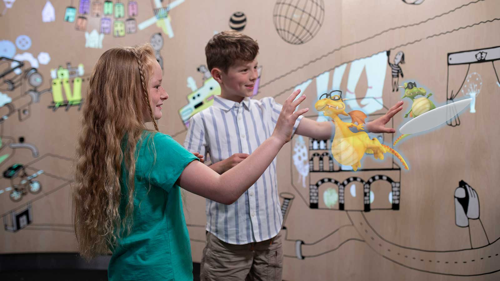 Children playing with virtual 3D dragons, spatial computing example