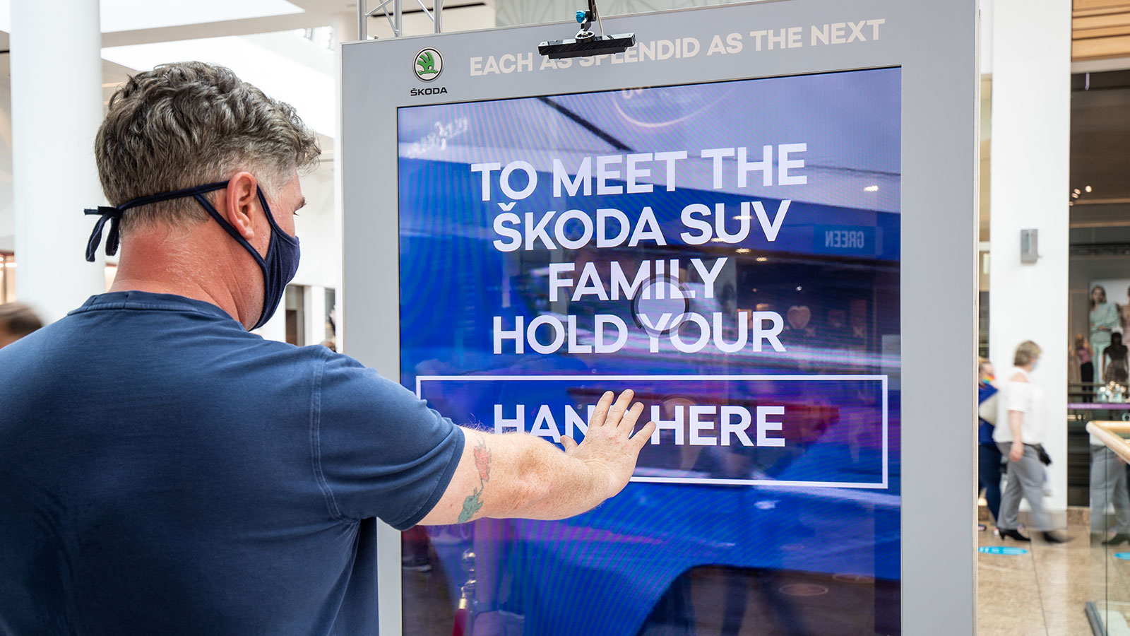 Skoda interactive digital out-of-home advertising screen with Ultraleap touchless technology