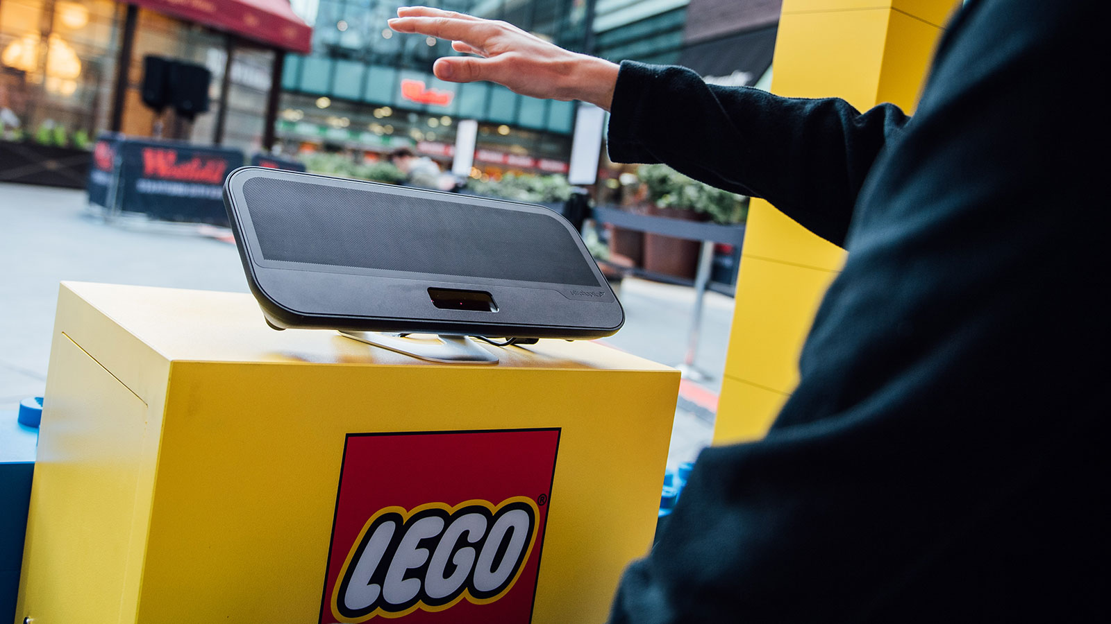 Hand interacting with haptic device in Lego experience