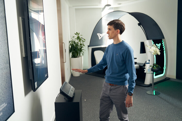 Person interacting with mid-air haptics movie poster